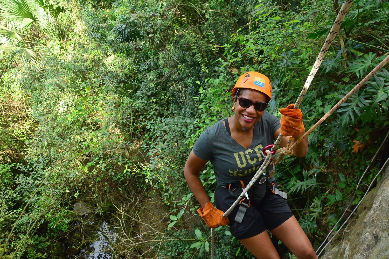 Marcea repelling into a cenote in Mexico